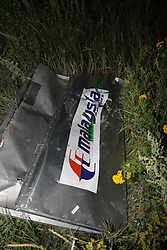 Image ©Licensed to i-Images Picture Agency. 17/07/2014.<br /> 61849947<br /> Shakhtarsk, Ukraine. The debris at the crash site of a passenger near the city of Shakhtarsk in Ukraine's Donetsk region. The crash of a Malaysian passenger plane in Ukraine on Thursday was shrouded in mystery of a deliberate attack, with Kiev trading accusations of blame with separatists and Moscow. Photo by imago / i-Images.<br /> <br /> UK ONLY