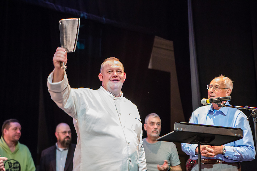 Flushing, NY - February 25, 2017. David Noeth of New York Epicurean Events with the grand prize cleaver at the 2017 Charcuterie Masters at Flushing Town Hall. The grand prize was awarded to Mark Elia of the Hudson Valley Sausage Company.