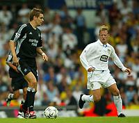 Photo Aidan Ellis.<br />Leeds United v Newcastle United (FA Barclaycard Premiership) 17/08/2003.<br />Newcastle's Johnathon Woodgate and Leeds David Batty.