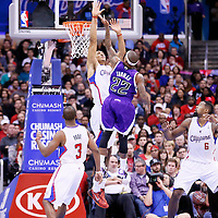 23 November 2013: Sacramento Kings point guard Isaiah Thomas (22) goes for the layup against Los Angeles Clippers center Ryan Hollins (15) during the Los Angeles Clippers 103-102 victory over the Sacramento Kings at the Staples Center, Los Angeles, California, USA.