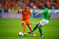 NETHERLANDS, Amsterdam In action Wesley Sneijder versus Niall McGinn (r) Northern Irland during friendly soccer match between Netherlands vs Northern Irland in Rotterdam on June 2, 2012. AFP PHOTO/ ROBIN UTRECHT
