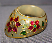 Thumb Ring.  Mughal, 17th century.  White nephrite jade set with emeralds, rubies and a diamond.