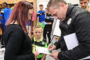 Forest Green Rovers assistant manager, Scott Lindsey signs a match day programme for the mascot during the EFL Sky Bet League 2 match between Forest Green Rovers and Newport County at the New Lawn, Forest Green, United Kingdom on 14 October 2017. Photo by Shane Healey.