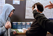 DISCARDA, WILE OUT ONEZ EMCEE, IN A LIMEHOUSE BOOKMAKERS. EAST LONDON 2005.
