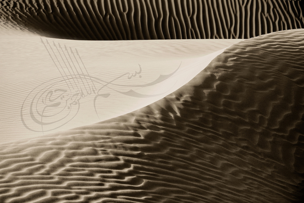 Desert sand dunes with arabic calligraphy.