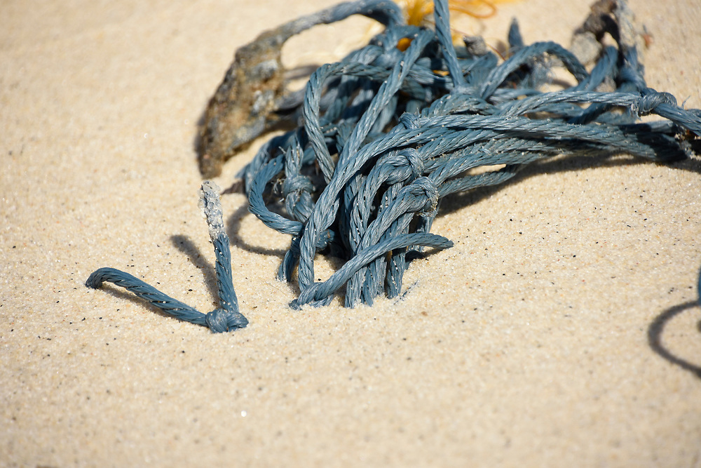 Assorted ropes on a beach