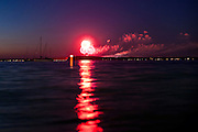 Seen from near the Memorial Union Terrace at the University of Wisconsin-Madison across Lake Mendota, fireworks from the annual Rhythm and Booms show light up the night sky above Warner Park in Madison, Wis., on July 2, 2011.