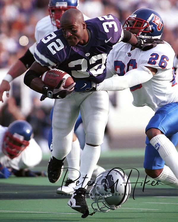 Kansas State's David Allen (32) loses his helmet while returning a punt during game action against Kansas at KSU Stadium in Manhattan, Kansas in 1997.
