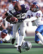 Kansas State's David Allen (32) loses his helmet while returning a punt during game action against Kansas at KSU Stadium in Manhattan, Kansas in 1997.