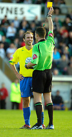 Photo: Ed Godden.<br /> Milton Keynes Dons v Hereford United. Coca Cola Championship. 21/10/2006. Hereford's John Eustace laughs at Referee Darren Deadman as he is shown the yellow card.