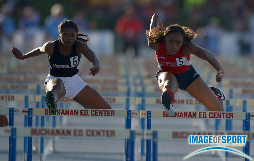 Jun 7, 2014; Clovis, CA, USA; Mecca McGlaston of Dublin (right) defeats Pattriana Perry of Vacaville to win the girls 100m hurdles in a wind-aided 13.54 in the 96th CIF State Track and Field championships at Veterans Memorial Stadium.