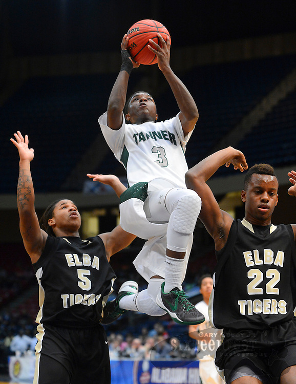 Gary Cosby Jr./Decatur Daily     Tanner's Markel Mull drives and shoots over Elba's Darrean Burks  and Elba's Caleb Martin during Tanner's 61-52 loss to Elba in the state semi-final game Tuesday at the Birmingham Jefferson Civic Center.