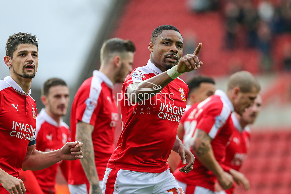 Swindon Town's Jonathan Obika celebrates his and Swindons 1st goal during the Sky Bet League 1 match between Swindon Town and Gillingham at the County Ground, Swindon, England on 26 December 2015. Photo by Shane Healey.