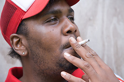 Young man taking a drag from a cigarette,