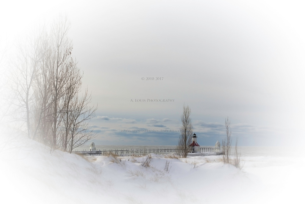 Winter scene of the St. Joe Piers and lighthouse with a winter coat of ice.  Holiday card edition