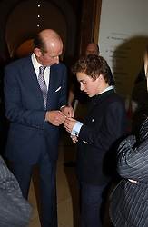 Left to right, HRH THE DUKE OF KENT and his grandson LORD DOWNPATRICK  at the Depal Trust 2in1 Art Party at The National Portrait Gallery, London on 25th October 2004.<br />