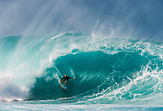 Russell Bierke surfing at the Banzai Pipeline, North Shore, Oahu, Hawaii