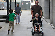 A young boy gives a rose to an old woman in the neighbourhood of Gracià in Barcelona during the international day of the Elderly (October 2, 2010).