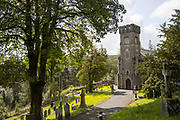 HAFOD, WALES, UK 17TH AUGUST 2019 - Hafod Church on a sunny day with graveyard, and countrside woodland background. Hafod, County of Ceredigion, Mid Wales, UK.