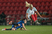 Rachel Daly (England) is fouled by Elise Bussaglia (France) during the International Friendly match between England Women and France Women at the Keepmoat Stadium, Doncaster, England on 21 October 2016. Photo by Mark P Doherty.