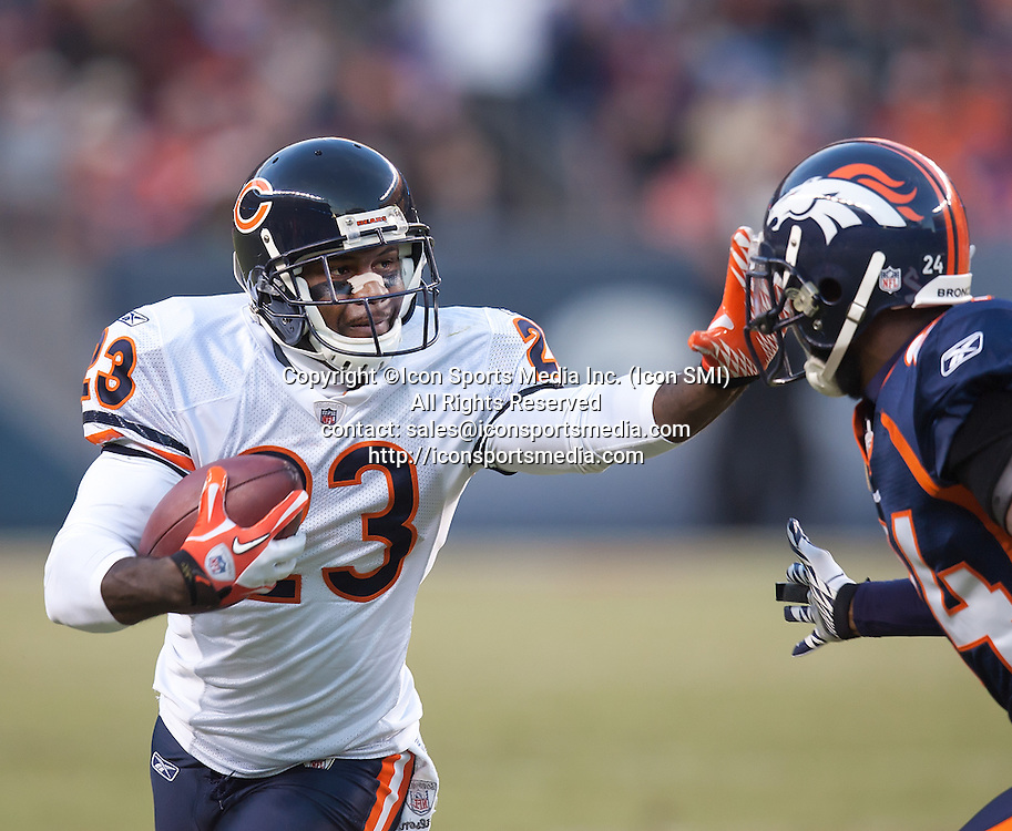 Dec. 11, 2011 - Denver, Colorado, U.S - Chicago Bears DEVIN HESTER, left, returns a punt for yardage against Denver Broncos CB CHAMP BAILEY, right, during the 3rd. quarter at Sports Authority Field at Mile High Sunday afternoon. The Broncos beat the Bears in OT 13-10