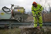 Rob Gault of Pipe-Eye Sewer cleans a manhole in Lockport, New York on Friday, December 4, 2015. Pipe-Eye is based in Bradford, Pennsylvania.