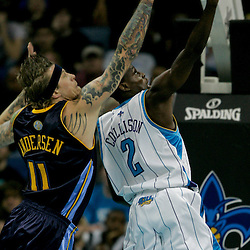Dec 18, 2009; New Orleans, LA, USA;  New Orleans Hornets guard Darren Collison (2) shoots over Denver Nuggets center Chris Andersen (11) during the second half at the New Orleans Arena. The Hornets defeated the Nuggets 98-92. Mandatory Credit: Derick E. Hingle-US PRESSWIRE