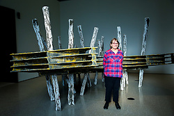 © Licensed to London News Pictures. 01/01/2019. London, UK. Phyllida Barlow poses in front of her artwork at Royal Academy of Arts. British artist Phyllida Barlow transforms the Royal Academy's Gabrielle Jungels-Winkler Galleries with an exhibition of entirely new work, entitled cul-de-sac. The exhibition has been conceived as a sequential installation running across all three of the interconnected spaces. The exhibition is open to the public from 23 February until 23 June 2019. Photo credit: Dinendra Haria/LNP
