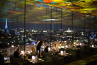 Vienna, Austria- November, 2014: Patrons enjoy dinner with a view at Le Loft, a restaurant perched atop the Sofitel in Vienna. The highlight is the projection ceiling designed by artist Pipilotti Rist, which appears to extend into the Vienna skyline by virtue of its reflection. CREDIT: Chris Carmichael for The New York Times