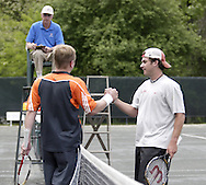 Ints Kalps, from Huber Heights watches from the official's chair as Art Peller (left) shakes hands with Ross Wilson after Peller won the 41st Weston Memorial Tennis Tournament at the Virginia Hollinger Memorial Tennis Club, Monday, May 26, 2008.