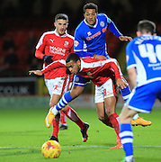 Yaser Kasim, Nathaniel Mendez-Laing during the Sky Bet League 1 match between Swindon Town and Rochdale at the County Ground, Swindon, England on 12 December 2015. Photo by Daniel Youngs.