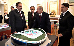 October 3, 2017 - Moscow, Russia - October 3, 2017. - Russia, Moscow. - Russian President Vladimir Putin (2nd right) at an exhibit on preparation of stadiums and airports in the 2018 FIFA World Cup host cities before a meeting of the Presidential Council for Development of Physical Culture and Sport. From left: Prime Minister of Tatarstan Aleksey Pesoshin and Deputy Prime Minister Vitaly Mutko. Right: Presidential Aide Igor Levitin. (Credit Image: © Russian Look via ZUMA Wire)