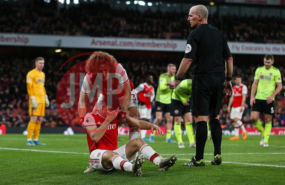 Gabriel Martinelli of Arsenal is helped up by David Luiz - Mandatory by-line: Arron Gent/JMP - 18/01/2020 - FOOTBALL - Emirates Stadium - London, England - Arsenal v Sheffield United - Premier League
