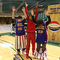 Libby Ezell | BUY AT PHOTOS.DJOURNAL.COM<br /> Jacob Pitts, left 15, laughs as Ramsey, the Harlem Globetrotters Hypeman, tricks his brother, Jordan 12, into dropping his Globetrotter shorts by raising their hands for a photos