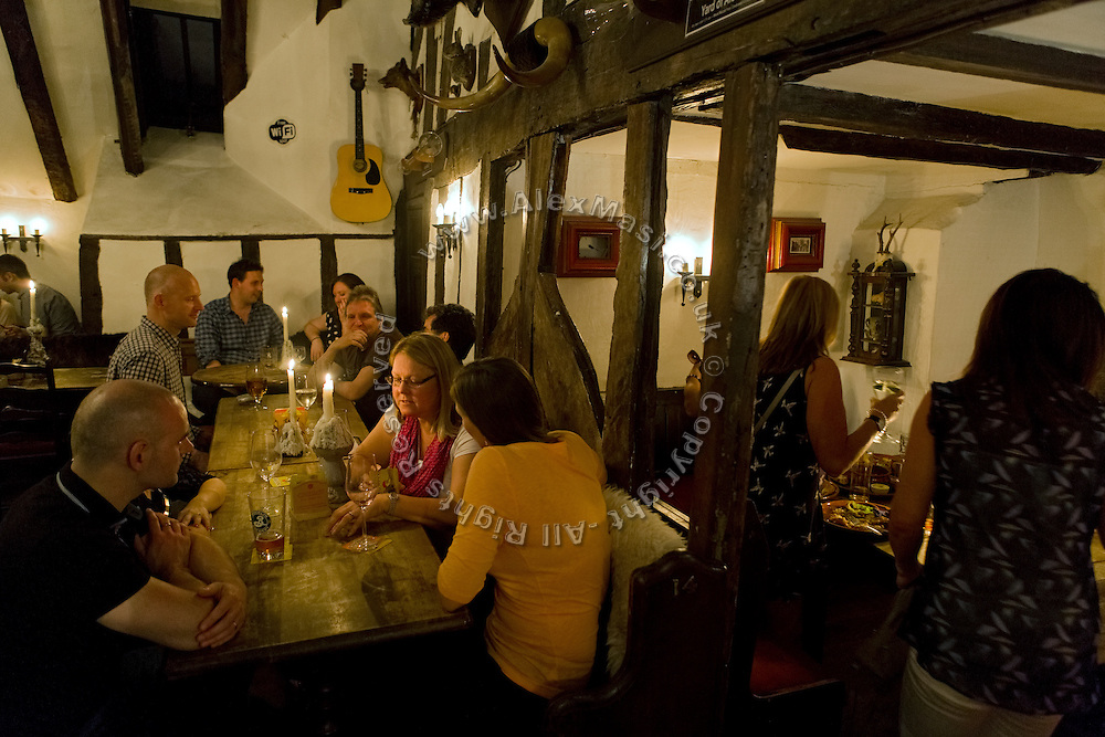 People are having a drink at the House Of The Trembling Madness pub in York, Yorkshire, England, United Kingdom.