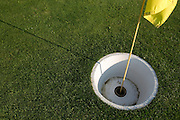 The hole is required to be between 50 and 53 centimeters in diameter. The game is played on golf courses, and requires players to kick a soccer ball into a large hole.