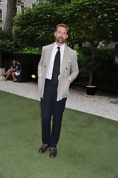 Designer PATRICK GRANT at a garden party hosted by Piaget at The Hempel Hotel, London on 14th July 2011.