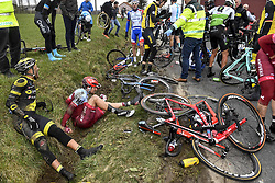 March 23, 2018 - Harelbeke, BELGIUM - French Yohann Gene of Direct Energie and Austrian Marco Haller of Katusha-Alpecin sit by the side of the road after a fall during the 61st edition of the 'E3 Prijs Vlaanderen Harelbeke' cycling race, 206,5 km from and to Harelbeke, Friday 23 March 2018. BELGA PHOTO DIRK WAEM (Credit Image: © Dirk Waem/Belga via ZUMA Press)