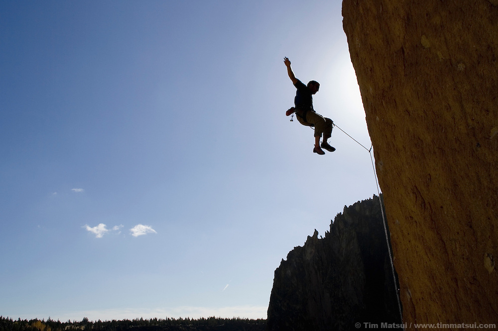 A sport climber falls from high on Latest Rage, 5.12b, on a steep cliff at Smith Rock State Park near Bend, Oregon.