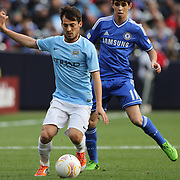 David Silva, Manchester City, (left) and Oscar, Chelsea, in action during the Manchester City V Chelsea friendly exhibition match at Yankee Stadium, The Bronx, New York. Manchester City won the match 5-3. New York. USA. 25th May 2012. Photo Tim Clayton