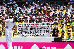 © Licensed to London News Pictures. 03/01/2014. Australian fans hold up a humorous banner behind England Captain Alastair Cook  during the 5th Ashes Test Match between Australia Vs England at the SCG on 03 January, 2013 in Melbourne, Australia. Photo credit : Asanka Brendon Ratnayake/LNP