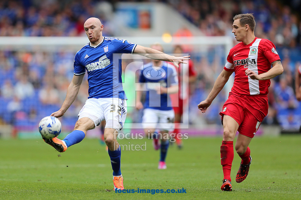 Conor Sammon of Ipswich Town controls the ball despite the attentions of Matthew Kilgallon of Blackburn Rovers during the Sky Bet Championship match at Portman Road, Ipswich<br /> Picture by Richard Calver/Focus Images Ltd +447792 981244<br /> 18/10/2014