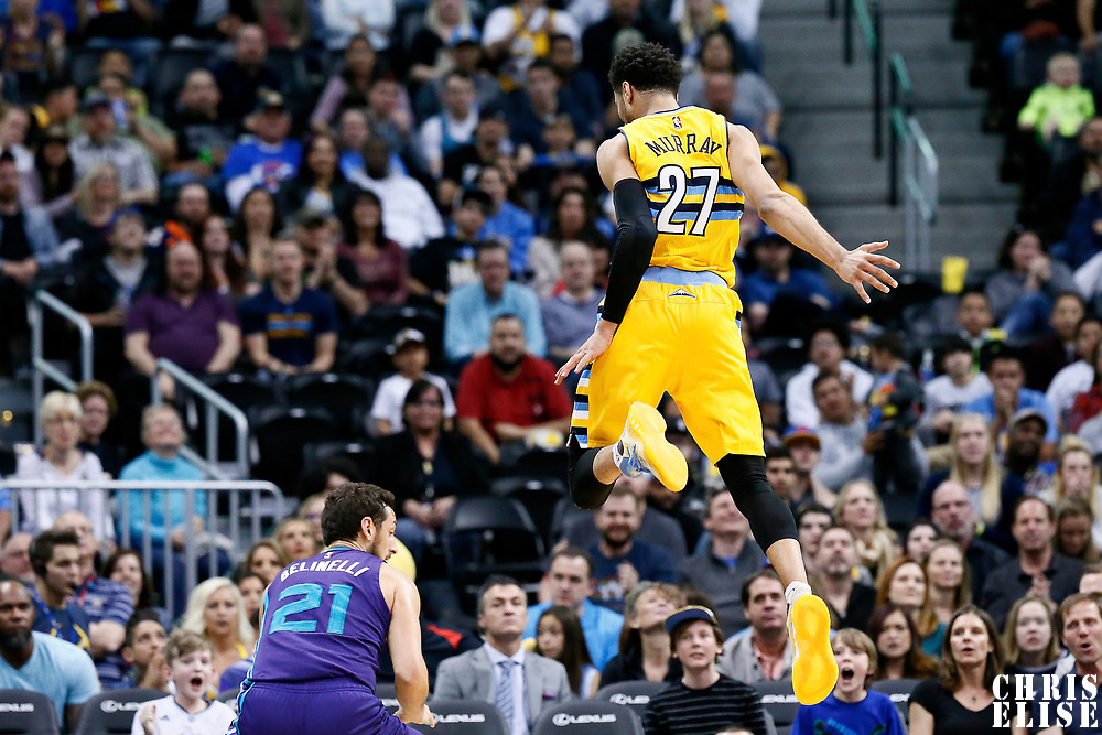 04 March 2017: Denver Nuggets guard Jamal Murray (27) jumps as Charlotte Hornets guard Marco Belinelli (21) fakes a jump shot during the Charlotte Hornets 112-102 victory over the Denver Nuggets, at the Pepsi Center, Denver, Colorado, USA.