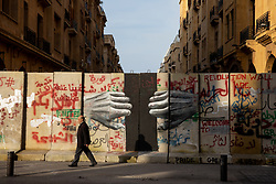 © Licensed to London News Pictures. 27/01/2020. Beirut, Lebanon. A man walks past a graffitied security wall around the government buildings in Downtown Beirut, as the government votes on the 2020 budget. Anti government demonstrators have been campaigning against government corruption and economic crisis for 103 days in Lebanon. Photo credit : Tom Nicholson/LNP