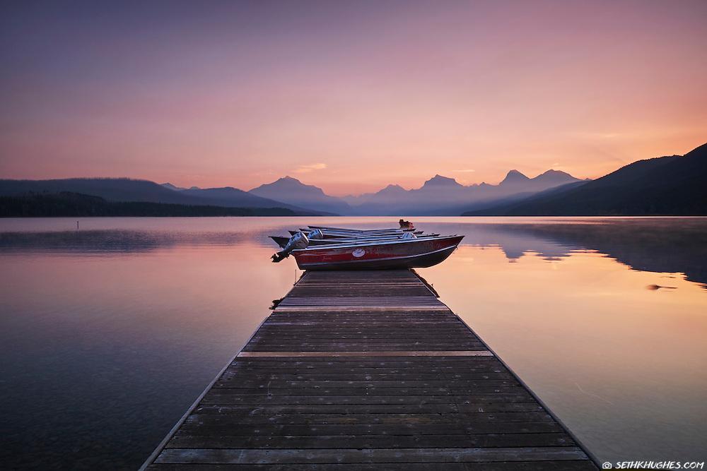 Boats for rent at dawn on the dock at Lake McDonald, Glacier National Park, Montana.