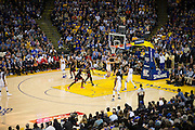Golden State Warriors guard Klay Thompson (11) takes the ball to the basket against the Houston Rockets at Oracle Arena in Oakland, Calif., on December 1, 2016. (Stan Olszewski/Special to S.F. Examiner)