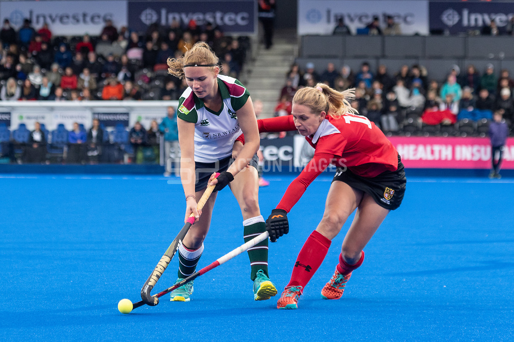 Surbiton's Anabel Herzsprung is tackled by Leah Wilkinson of Holcombe. Holcombe v Surbiton - Investec Women's Hockey League Final, Lee Valley Hockey & Tennis Centre, London, UK on 29 April 2018. Photo: Simon Parker
