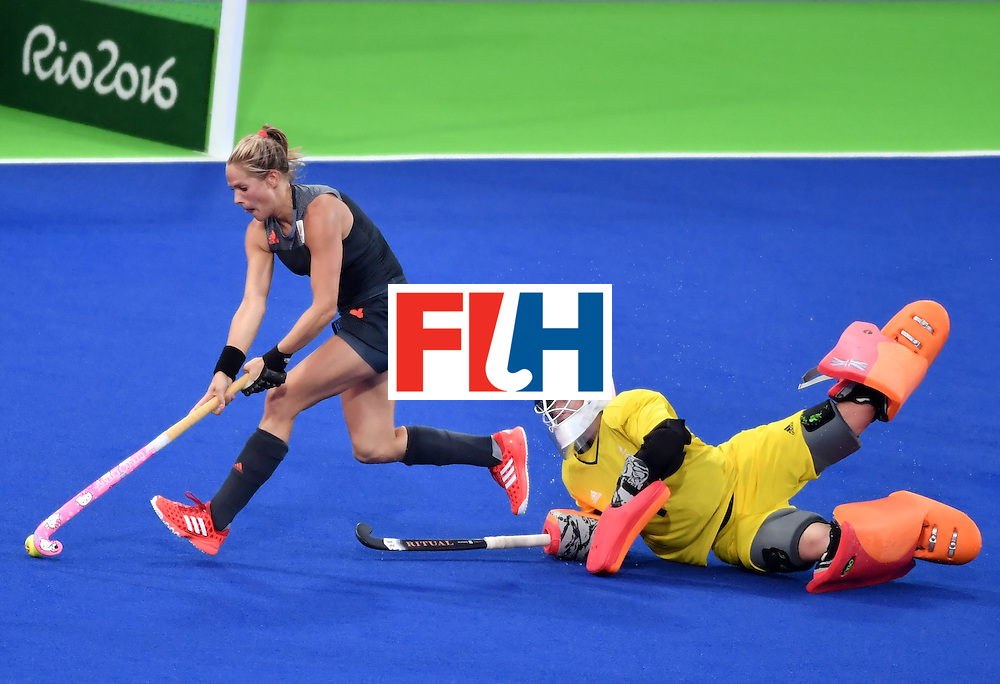 Netherlands' Kitty van Male (L) runs past Britain's goalkeeper Maddie Hinch to score a goal during the women's Gold medal hockey Netherlands vs Britain match of the Rio 2016 Olympics Games at the Olympic Hockey Centre in Rio de Janeiro on August 19, 2016. / AFP / Pascal GUYOT        (Photo credit should read PASCAL GUYOT/AFP/Getty Images)