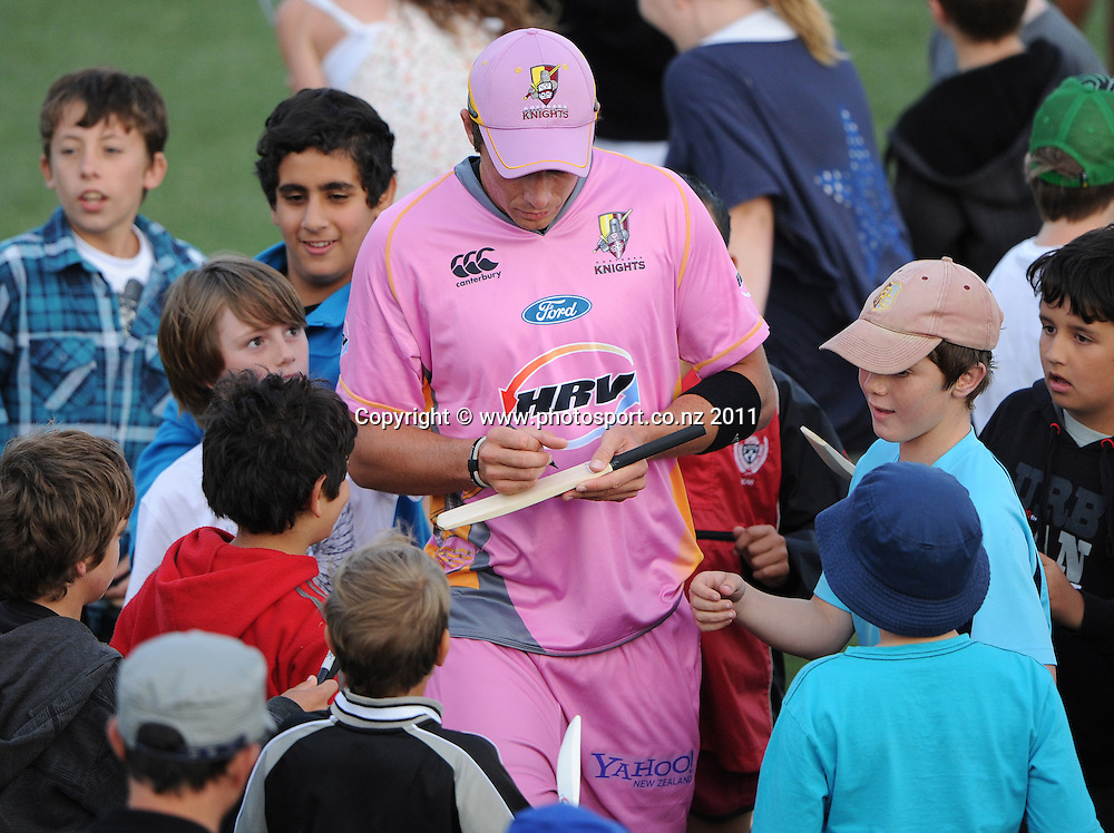 Tim Southee signs autographs at the conclusion of the HRV Twenty20 Cricket match between the Auckland Aces and Northern Knights at Colin Maiden Oval in Auckland on Monday 26 December 2011. Photo: Andrew Cornaga/Photosport.co.nz