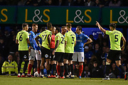 Peterborough United and Portsmouth players clash during the EFL Sky Bet League 1 match between Portsmouth and Peterborough United at Fratton Park, Portsmouth, England on 30 April 2019.